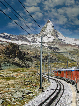 Passenger train traveling to the Gornergrat with a view of the Matterhorn in the foreground, Switzerland