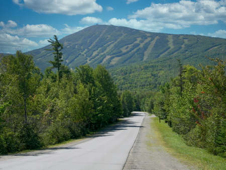 A road leading to the Sugarloaf Mountain Ski Resort in the state of Maine, USA