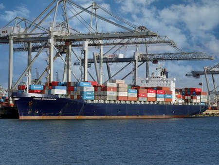A container ship at the Port of Rotterdam, the Netherlands