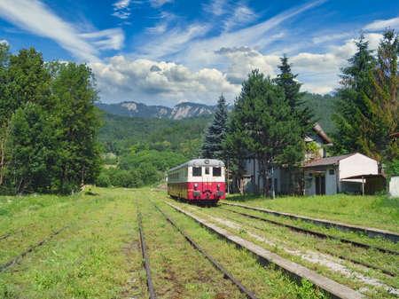 A diesel passenger car at a train station in Muran, Slovakia