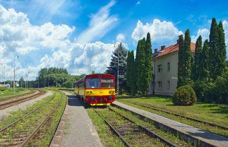 A passenger train at a train station in Kapusany pri Presove, Slovakia