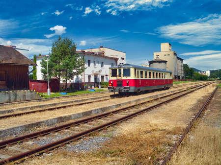 A passenger train at a train station in Krupina, Slovakia 免版税图像