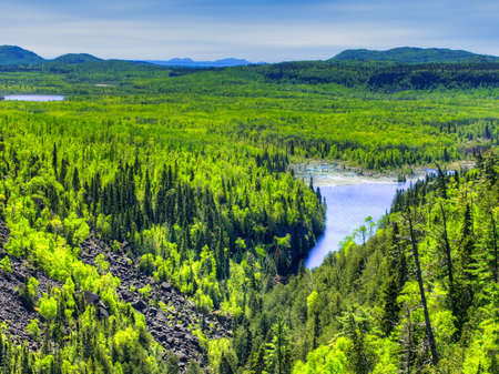 Forested landscape and lake in Ouimet Canyon Provincial Park, Ontario, Canada