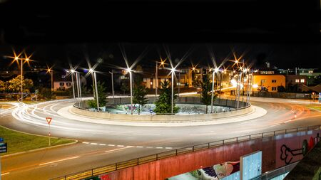 Light-extractors around a roundabout in the city of Innsbruck Editorial