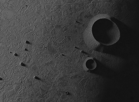 Asteroid or small plant. Craters and bumps. 3d illustration