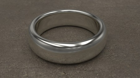 Shiny silver ring on table. 3d illustration