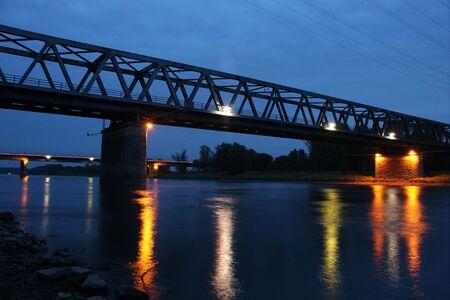 Illuminated railway bridge over the Elbe in Dessau-Ro�lau  Saxony-Anhalt, in the late evening twilight photo