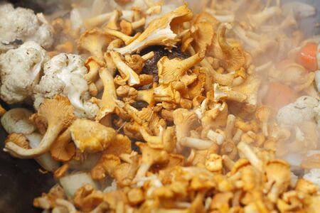 golden chanterelle: Golden Chanterelle during frying Stock Photo