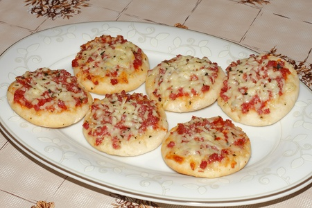 mini pizza: Six mini pizza on a plate Stock Photo