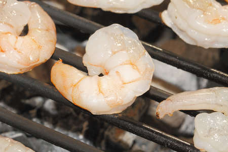 Grill with grilled shrimp at a barbecue photo