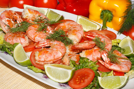 Fried prawns with salad on a plate Stock Photo
