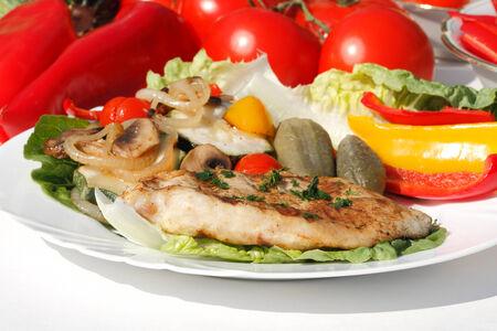 Grilled turkey steak with different vegetables photo