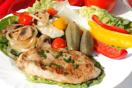 Grilled turkey steak with different vegetables