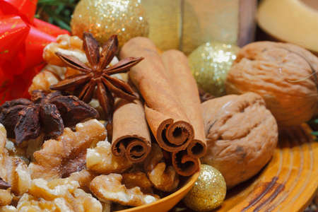 Cinnamon sticks and star anise with walnuts and christmas decoration