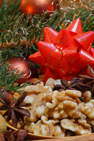 Walnuts and star anise with cinnamon sticks and christmas decoration