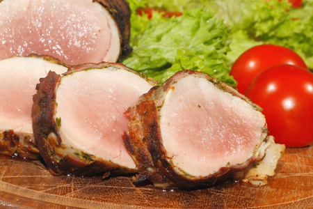 pork tenderloin: Pork tenderloin, pork medallions, pork, meat wrapped in bacon, grilled and garnished with lettuce and tomato on a wooden chopping board
