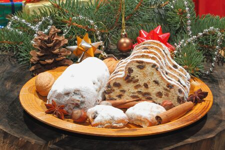 stollen: Christmas stollen with Christmas decoration, on a wooden plate