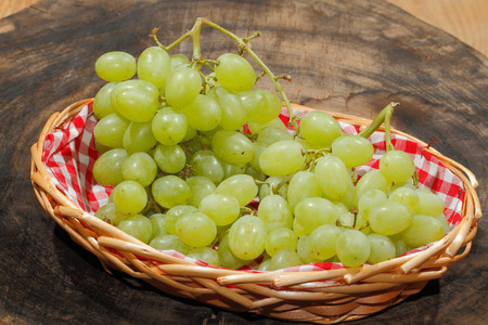 Freshly harvested grapes in a basket Stock Photo