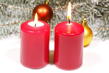 snowcovered: Advent candles with fir green and Christmas decoration in snow