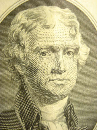 Macro shot of Thomas Jefferson on two dollar bill.