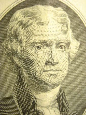 Macro shot of Thomas Jefferson on two dollar bill.