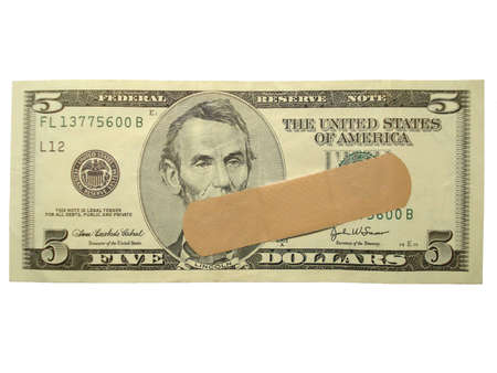 Five dollar bill with bandage isolated.