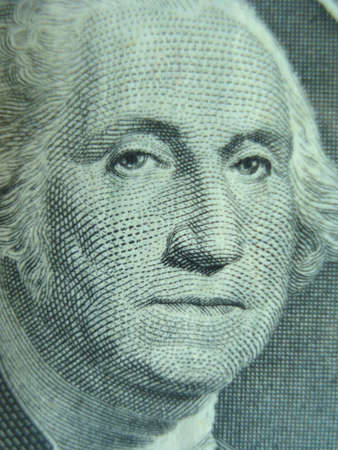 Macro shot of George Washington on one dollar bill. photo