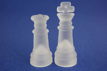 White frosted king and queen on blue background.
