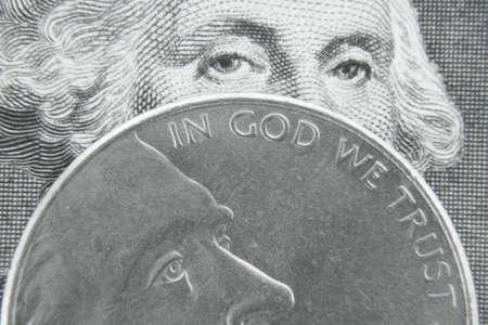 George Washington behind Jefferson nickel.