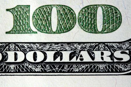 Macro shot of a 100 dollar bill.
