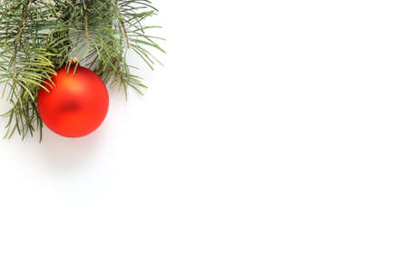 Christmas ornament with pine branch on white background.
