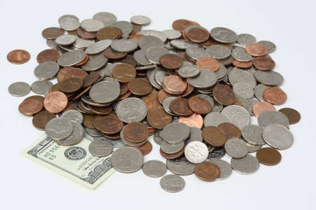 Piggy bank dumped out on white. Stock Photo - 4134405