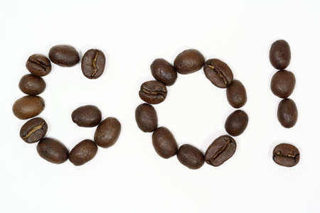 Macro shot of coffee beans arranged to say go.