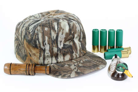 Hat, call, and shells for duck hunting. Focus on duck and call. photo