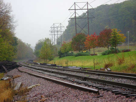 Rainy day railway crossing in the fall