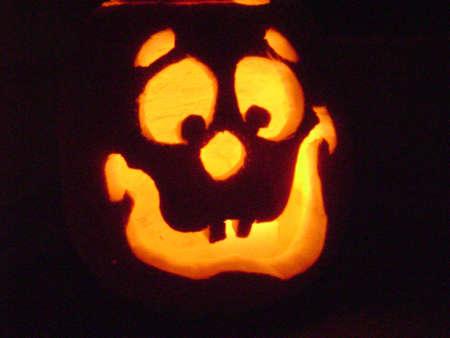Glowing halloween pumpkin happy face Stock fotó