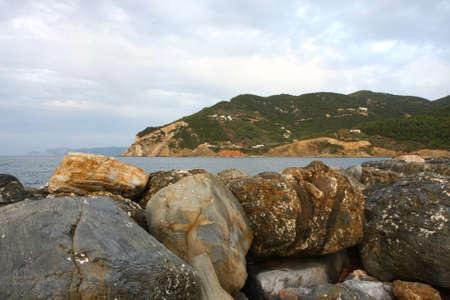 bulwark: Rocks on defensive bulwark in Skopelos town on Greek island Skopelos
