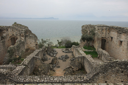 sirmione:  Roman ruins of Catull Grottos in rainy day at  Sirmione, Lake Garda, Italy