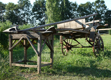two wheel: Old Serbian wooden two wheel horse carriage standig as showpiece