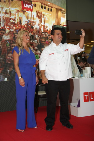 buddy: Cake boss Buddy Valastrothe star of TLC channel with his wife on 1 June 2015in shopping center Usce in BelgradeSerbiapromoting new programs and new season of the Cake boss tv show