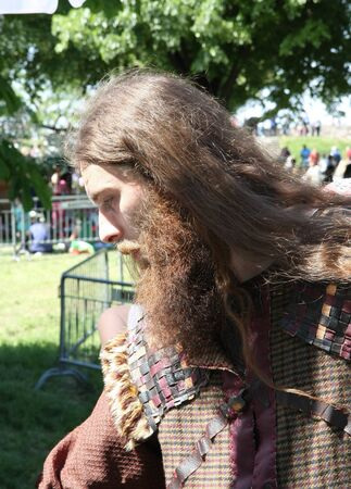 medeival: Portrait of  man with medieval clothes and hair at Belgrade Knight Fest held on 23 April in Belgrade,Serbia Editorial