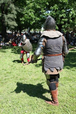 ax man: Demonstration of medieval  knight  fighting  at Belgrade Knight Fest held on 23 April in Belgrade,Serbia