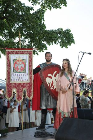 clothe: Participants of Belgrade Knight Fest held on 23 April in Belgrade,Serbia,posing on stage in medieval clothe
