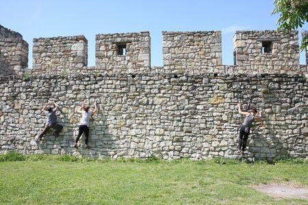 free climbing: People practicing  free climbing on the walls of Belgrade medieval  fortress Kalemegdan,23 April 2016  in Belgrade,Serbia