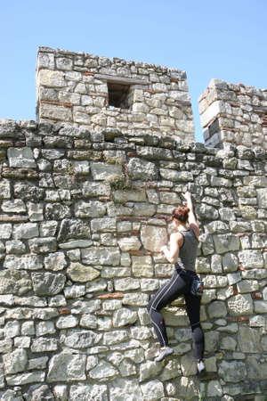 free climbing: Girl  practicing  free climbing on the walls of Belgrade medieval  fortress Kalemegdan,23 April 2016 in Belgrade,Serbia Editorial