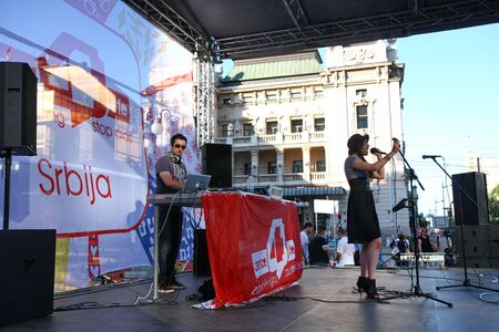 humane: BELGRADE,SERBIA-AUGUST 12, 2011:Zoe,singer of the band Zemlja gruva at the event dedicated to fighting AIDS under the name Dance4life Editorial