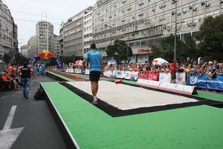 long jump: BELGRADE,SERBIA - SEPTEMBER 11 , 2016:Preparation of long jump runway for competition as promotion of European athletics indoors championship which will be held from 3-5.March ,2017 in Belgrade,Serbia Editorial