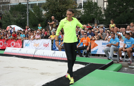 salto de longitud: BELGRADE,SERBIA - SEPTEMBER 11 , 2016: Erica Jarder testing long jump runway for competition as promotion of European athletics indoors championship which will be held from 3-5.March ,2017 in Belgrade,Serbia