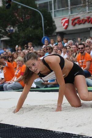 salto de longitud: BELGRADO, SERBIA - 11 de septiembre, 2016: Paola Borovic después de su salto en la competición de salto de longitud como la promoción del atletismo europeo en el interior de campeonato que tendrá lugar a partir 3-5.March de 2017 en Belgrado, Serbia