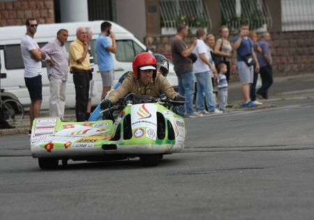 sidecar: BELGRADE,SERBIA - SEPTEMBER 10 , 2016: Oldtimer sidecar motorcycle at the commercial race of old cars in memory of formula 1 race, held on the same place in 1939 ,two days after the beginning of Second World War,when the famous Italian driver Tazio Nuvola